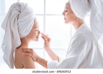 Profile picture of attentive woman that rubbing face