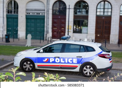 Profile of a police car in France in a city