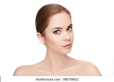 profile portrait of beautiful young blonde woman with green eyes