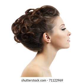Profile portrait of the beautiful young girl with curly hairstyle -  isolated on white background
