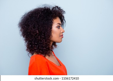 Profile portrait of charming pretty woman with modern hairdo in orange outfit isolated on grey background with copyspace empty place