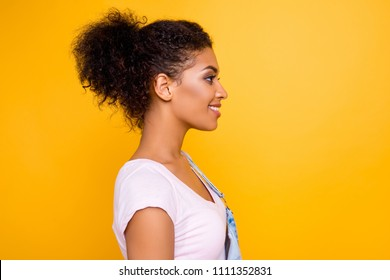 Profile portrait of cute gorgeous girl with beaming smile plump lips in casual outfit isolated on yellow background with copyspace empty place