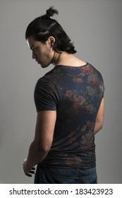 Profile portrait of handsome Malaysian man wearing flowery top