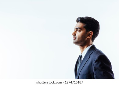 A profile portrait of a handsome man in suit and tie looking to side