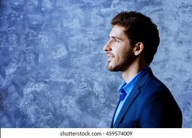 Profile portrait of a handsome man wearing elegant suit. Men's beauty, fashion. Businessman.