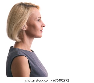 Profile portrait of a happy woman isolated on white background