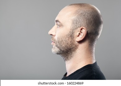 profile portrait of man isolated on gray background with copyspace