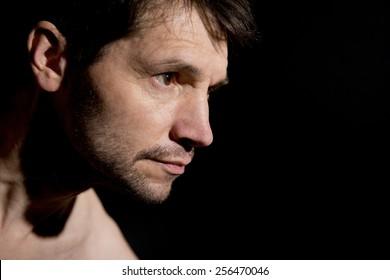 Profile Portrait Of Man In Shadow