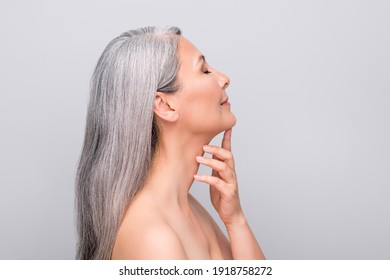 Profile portrait of optimistic nice long hair woman touch chin without clothes isolated on light grey color background