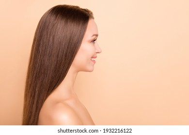 Profile portrait of positive adorable person look empty space no clothing isolated on beige color background