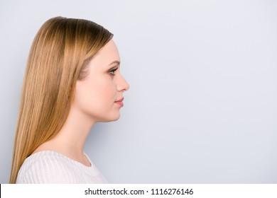Profile portrait of serious concentrated girl isolated on grey background with copyspace empty place. Health care wellness wellbeing treatment concept