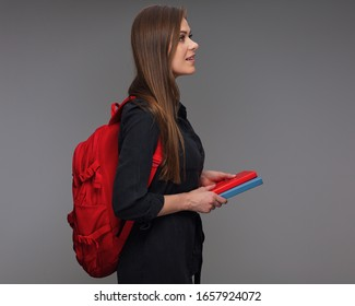 Profile portrait of woman student with backpack holding books. isolated portrait girl in black casual dress.