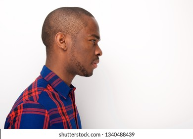 Profile portrait of young african american man against isolated white background