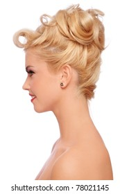 Profile portrait of young beautiful sexy blonde with stylish hairdo on white background