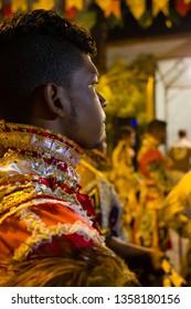 Profile portrait of a young black man in quadrilha costumes: typical dance of the June festivals in São Luís, Maranhão, northeast Brazil. June/2015.