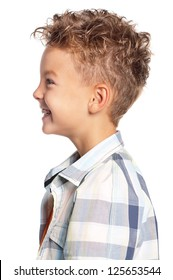 Profile portrait of young boy, isolated on white background
