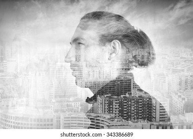 Profile portrait of young man combined with modern cityscape under cloudy sky, double exposure photo effect