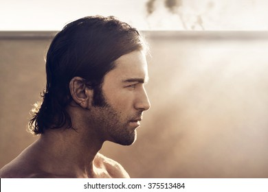 Profile portrait of young rugged man with vintage tone and style