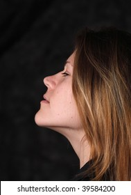 Profile portrait of young white woman