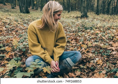 Profile portrait of young woman in forest
