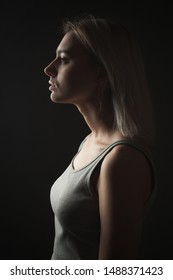 Profile portrait of young woman in studio