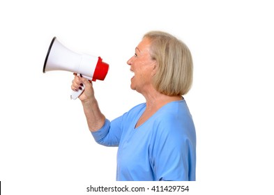 Profile of a senior woman using a megaphone to amplify her voice,conceptual of a protest, public speaking, rally or giving orders, upper body isolated on white