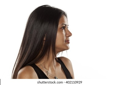 Profile of serious young dark-skinned pretty woman without makeup