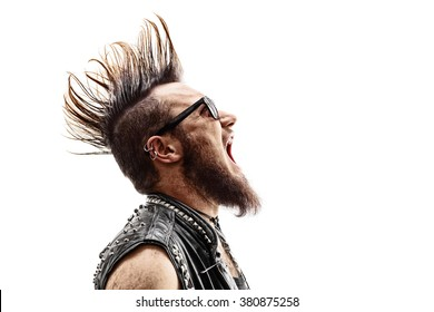 Profile shot of an angry young punk rocker with a Mohawk hairstyle screaming isolated on white background