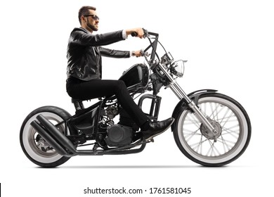 Profile shot of a biker on a custom chopper riding with sunglasses isolated on white background