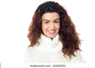 Profile shot of a happy lady with curly hair on white background.