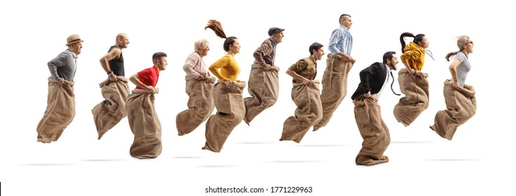 Profile shot of many people playing a gunny race and jumping with sacks isolated on white background