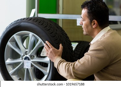 Profile shot of a mature male customer examining tires while shopping at the car dealership copyspace driving automotive repair motor driving vehicle consumerism buying service transport.