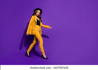 Profile side full length body size view of her she nice-looking glamorous attractive lovely well-dressed content wavy-haired lady motion isolated over bright vivid shine violet lilac background