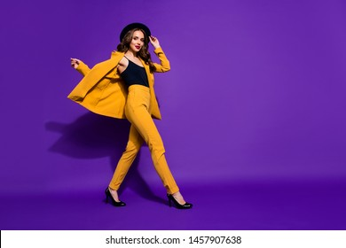 Profile side full length body size view of nice-looking glamorous gorgeous attractive content cheerful wavy-haired lady motion touching sunhat isolated over bright vivid shine violet lilac background