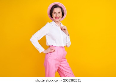 Profile side photo of aged attractive woman happy positive smile confident wear glamour outfit isolated over yellow color background
