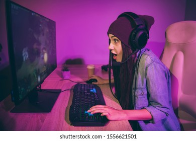 Profile side photo of astonished addicted crazy girl yelling commands to her team mates by using violet purple microphone with paper cup of coffee beside