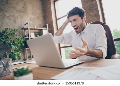 Profile side photo of frustrated crazy middle eastern senior marketer manager find plan mistake in review research feel burnout scream sit desktop in loft workstation
