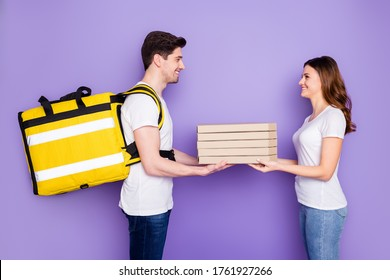 Profile side photo positive courier give girl pile stack delicious yummy pizza italian fast food cafeteria eat corona virus quarantine wear white denim jeans isolated violet color background