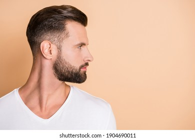Profile side photo of young handsome bristle man confident look empty space isolated over beige color background