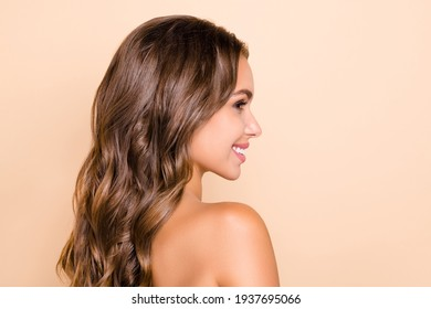 Profile side photo of young lovely dreamy girl with wavy silky perfect hair look copyspace isolated on beige color background