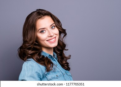 Profile side portrait of nice charming tender attractive cheerful magnificent adorable girl with wavy hair in casual denim shirt, isolated over grey background