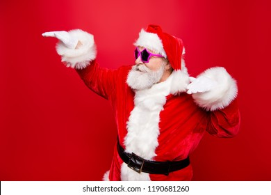 Profile side view cheerful positive carefree careless happiness aged mature Santa headwear tradition costume fooling around under music raised hands up isolated on noel red background