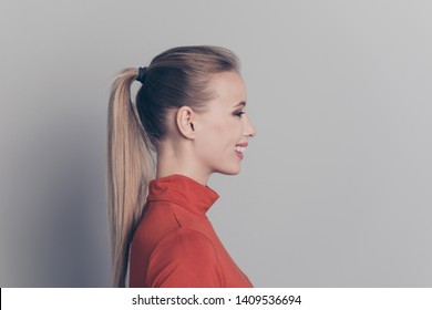 Profile side view close-up portrait of her she nice-looking lovely sweet adorable lovable attractive cheerful cheery girl in red sweater isolated over gray pastel background