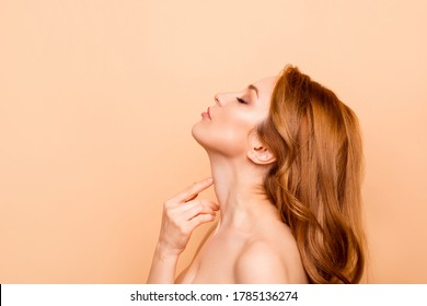 Profile side view close-up portrait of her she nice-looking attractive lovely gentle tender adorable wavy-haired lady enjoying touching smooth soft neck laser surgery isolated over beige background