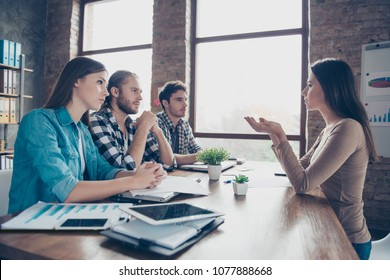 Profile, side view of coucher and employees of creative company having conversation, presentation, meeting, training, sitting at desktop in work station, place