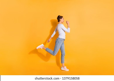 Profile side view full length body size photo of pretty attractive young woman workout practicing rushing outdoors in park in white denim outfit light sneakers isolated over colorful background