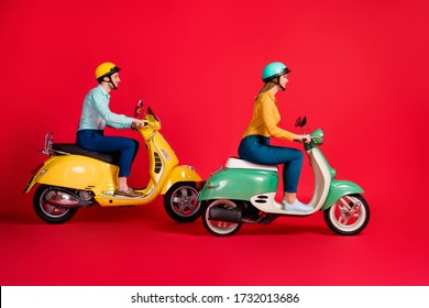 Profile side view of her she his he nice attractive cheerful cheery couple tourists riding moped traveling city tour isolated on bright vivid shine vibrant red color background