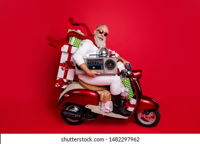 Profile side view of his he nice attractive cheerful cheery funky bearded gray-haired father delivering carrying desirable purchase discotheque isolated on bright vivid shine red background