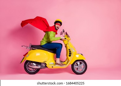 Profile side view of his he nice attractive funky worried guy driving moped fast speed wearing cape rescue safe planet late time isolated over pink pastel color background
