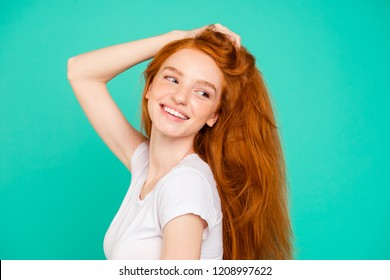 Profile side view photo of lovely woman in white polo look back or aside hold palm hands on head with long hair isolated on bright teal background